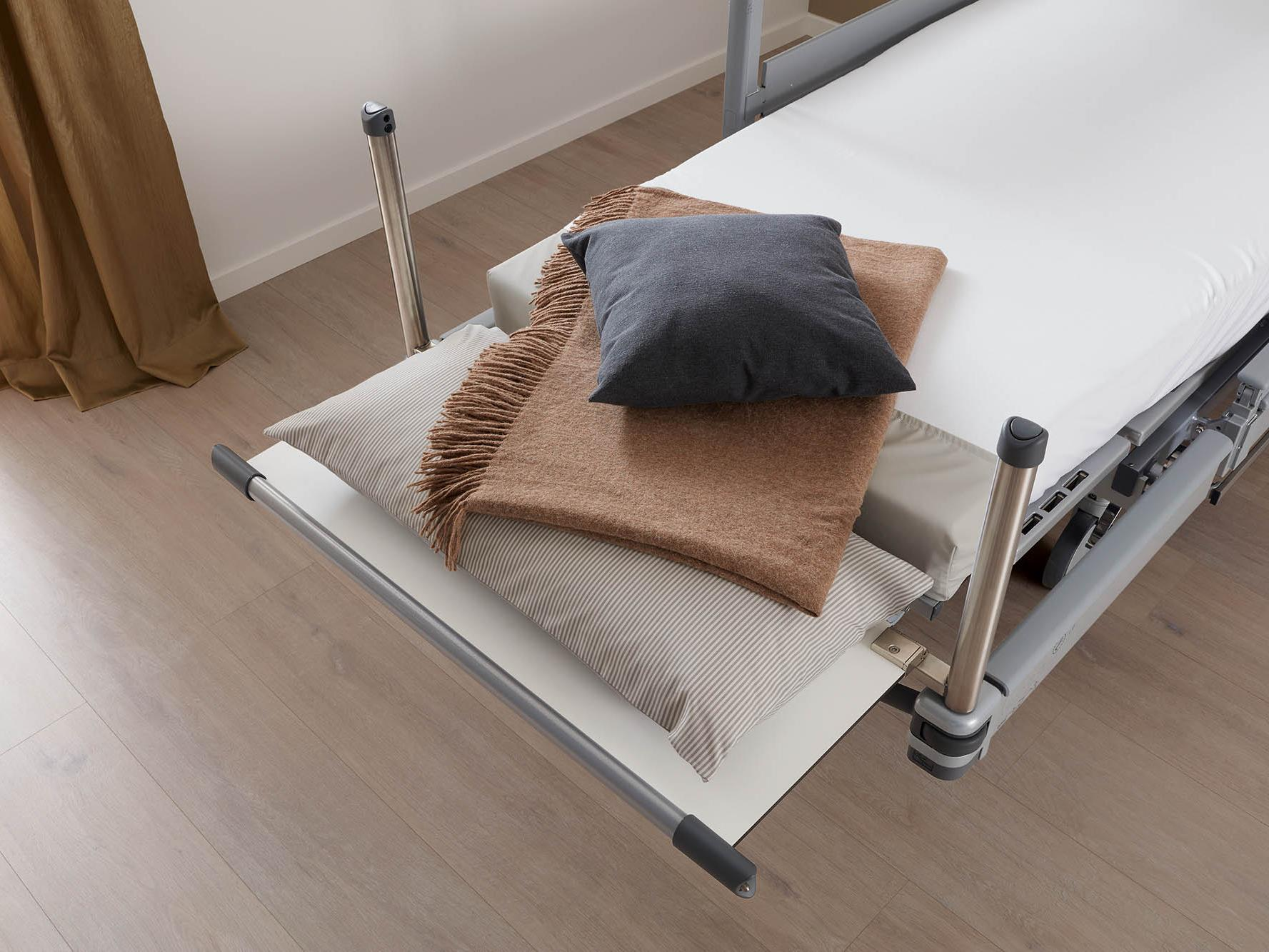 Footboard used as linen holder on the Vertica clinic mobilisation bed