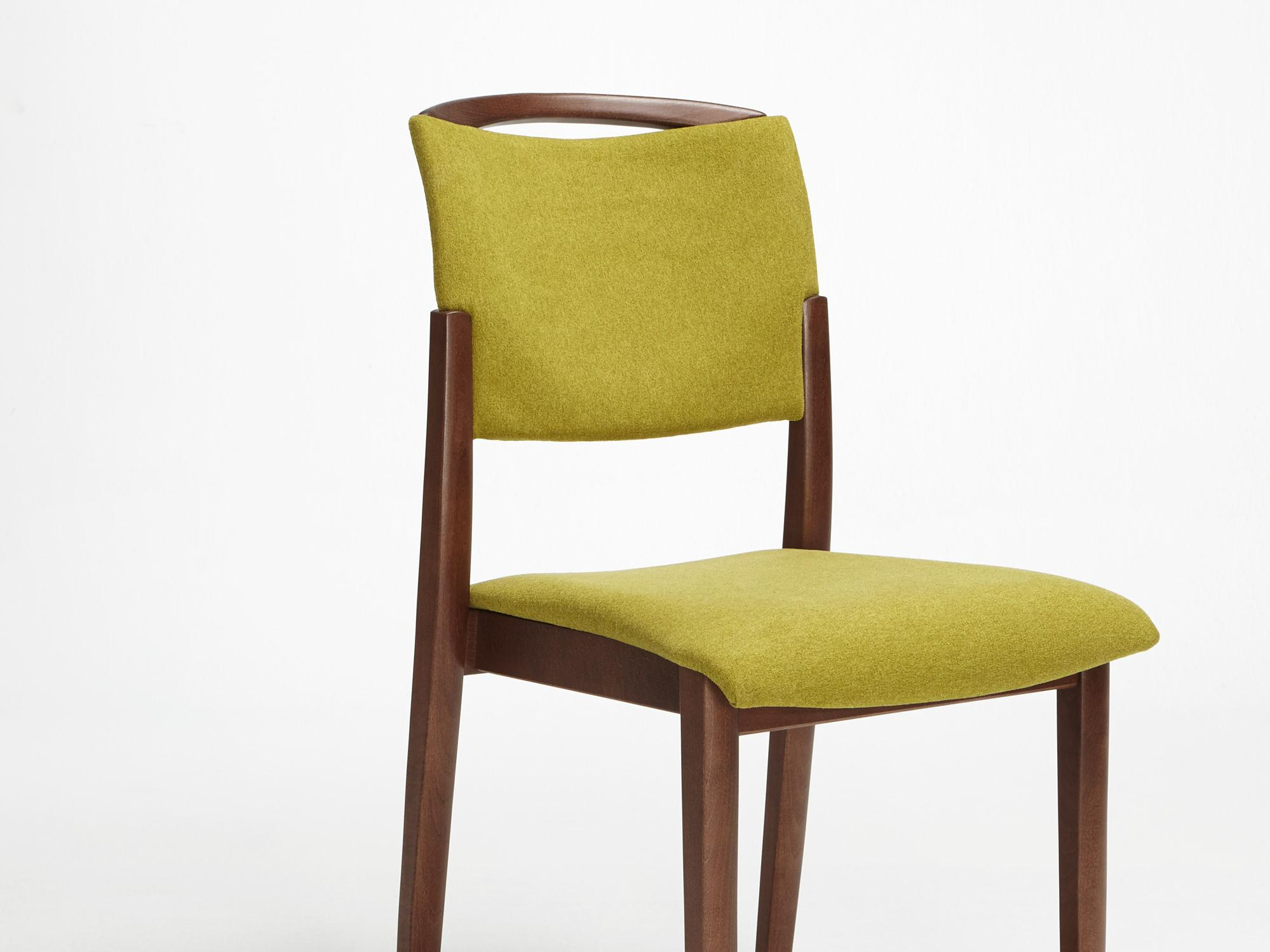 The Fena model as a stacking chair with handle and no armrests