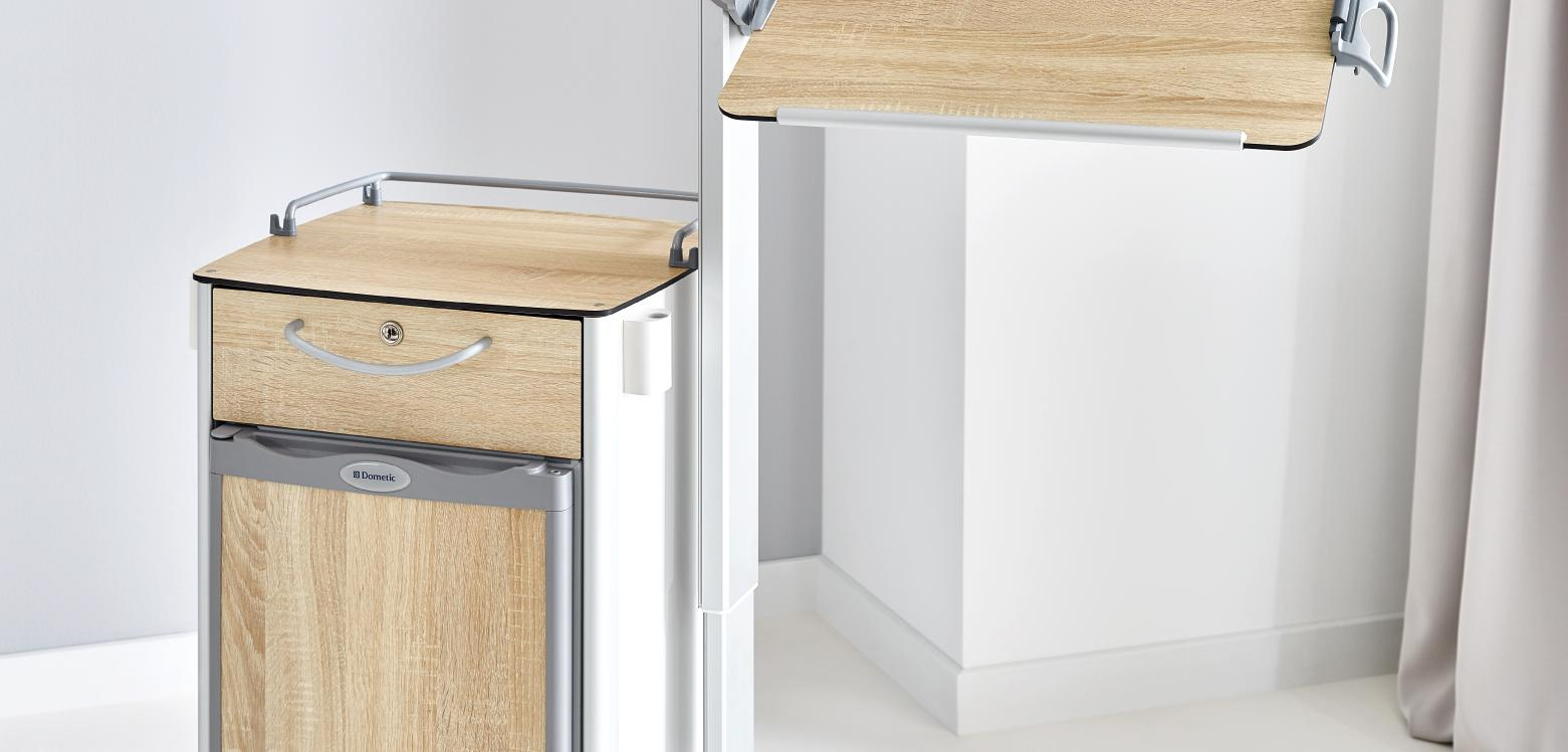 Tilting overbed table top on the Vitano bedside cabinet