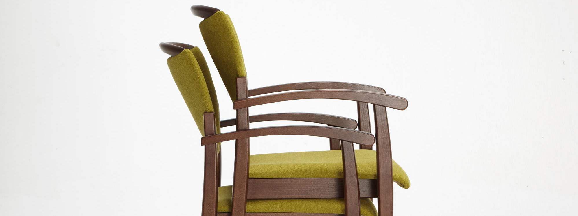 Stackable Fena chairs facilitate room cleaning