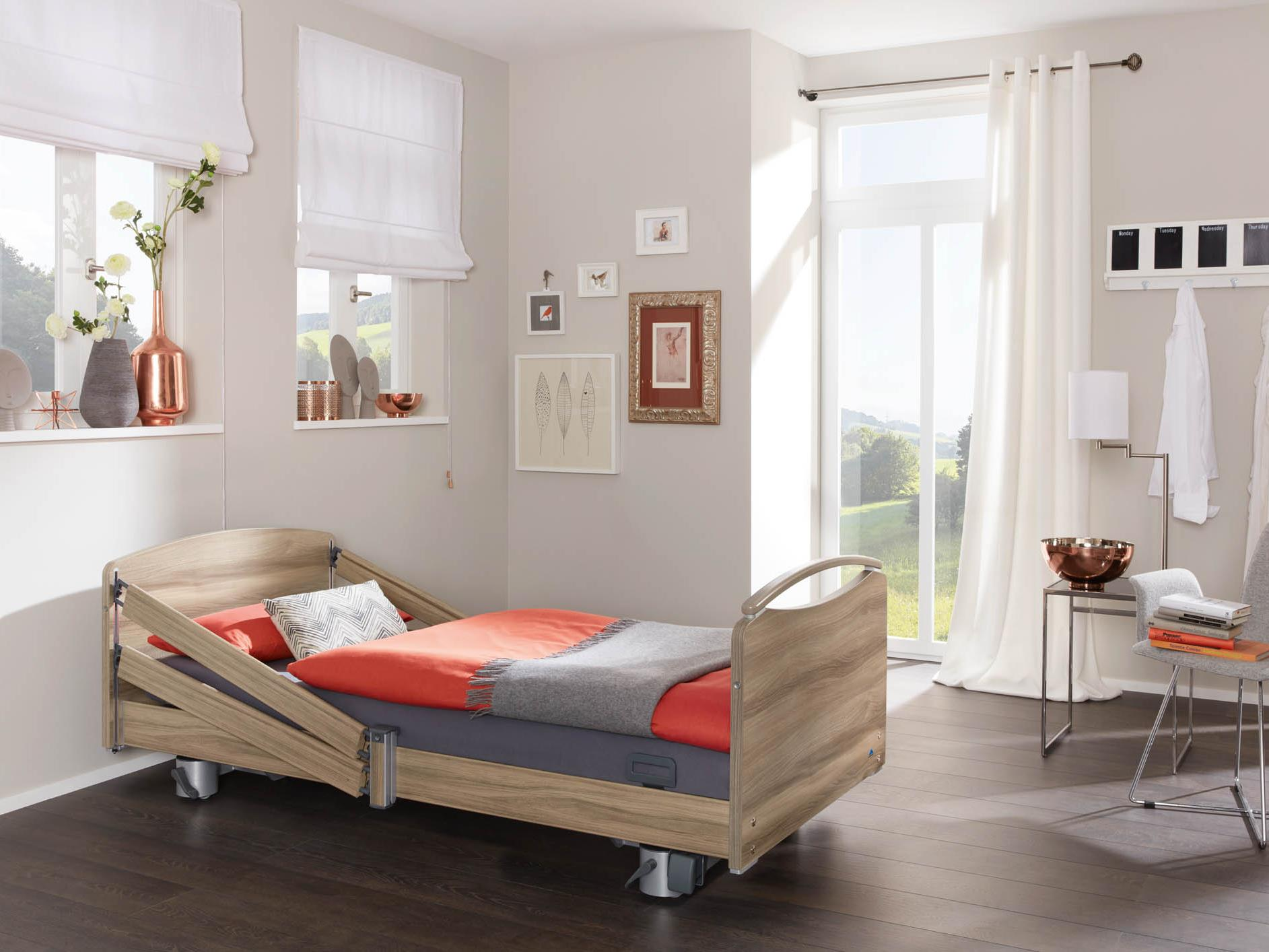 Elvido vervo low-height bed with a split safety side at the head end