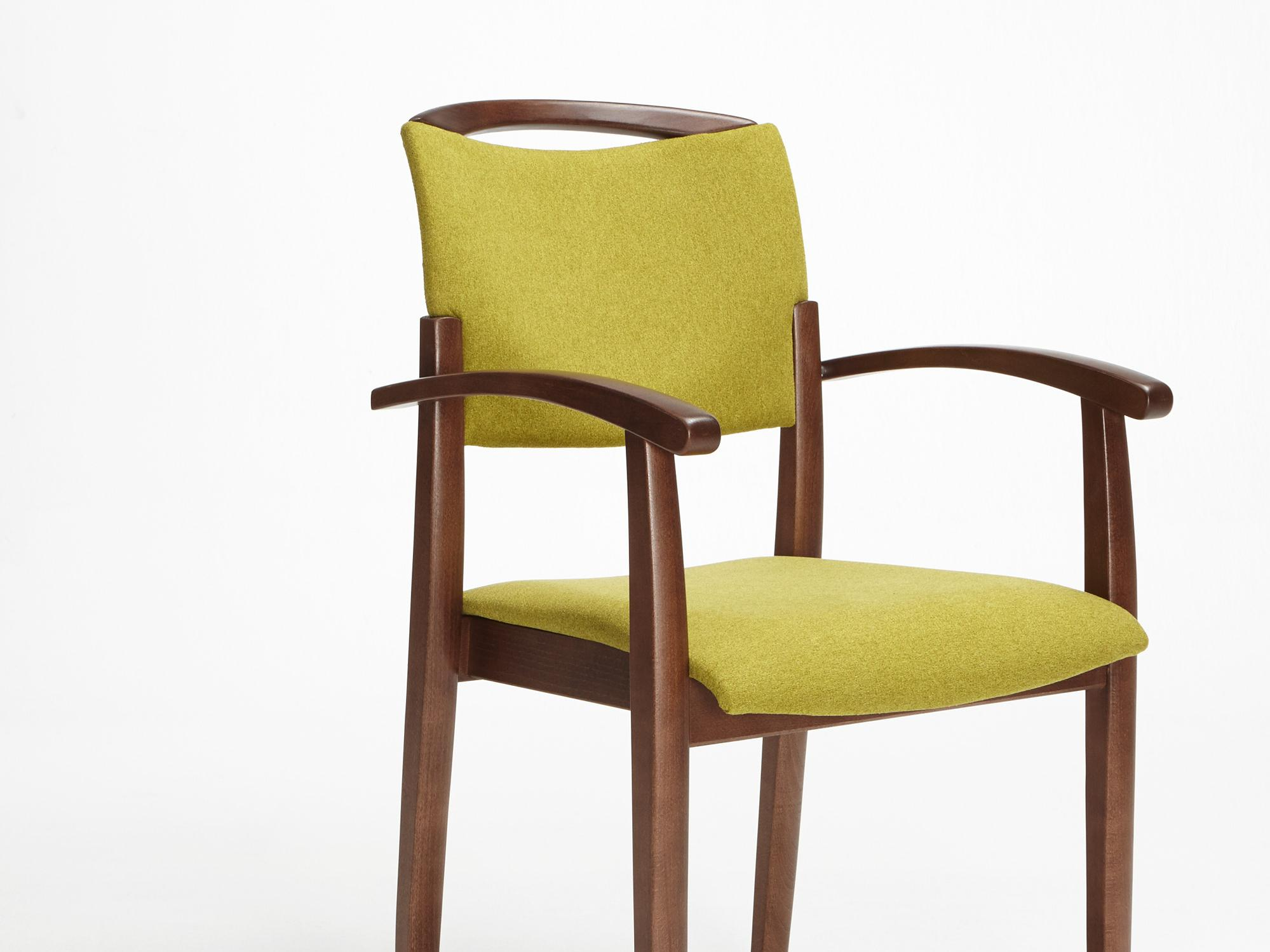 The Fena model as a stackable chair with armrests and handle rail