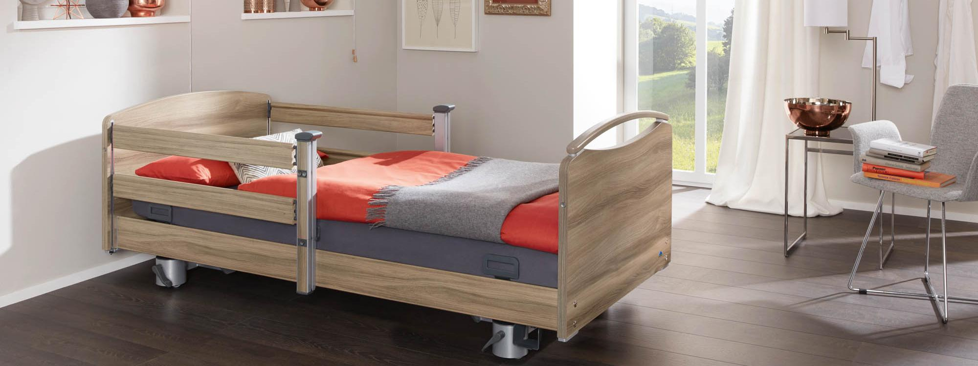 Combinable split safety side on the Elvido vervo low-height bed