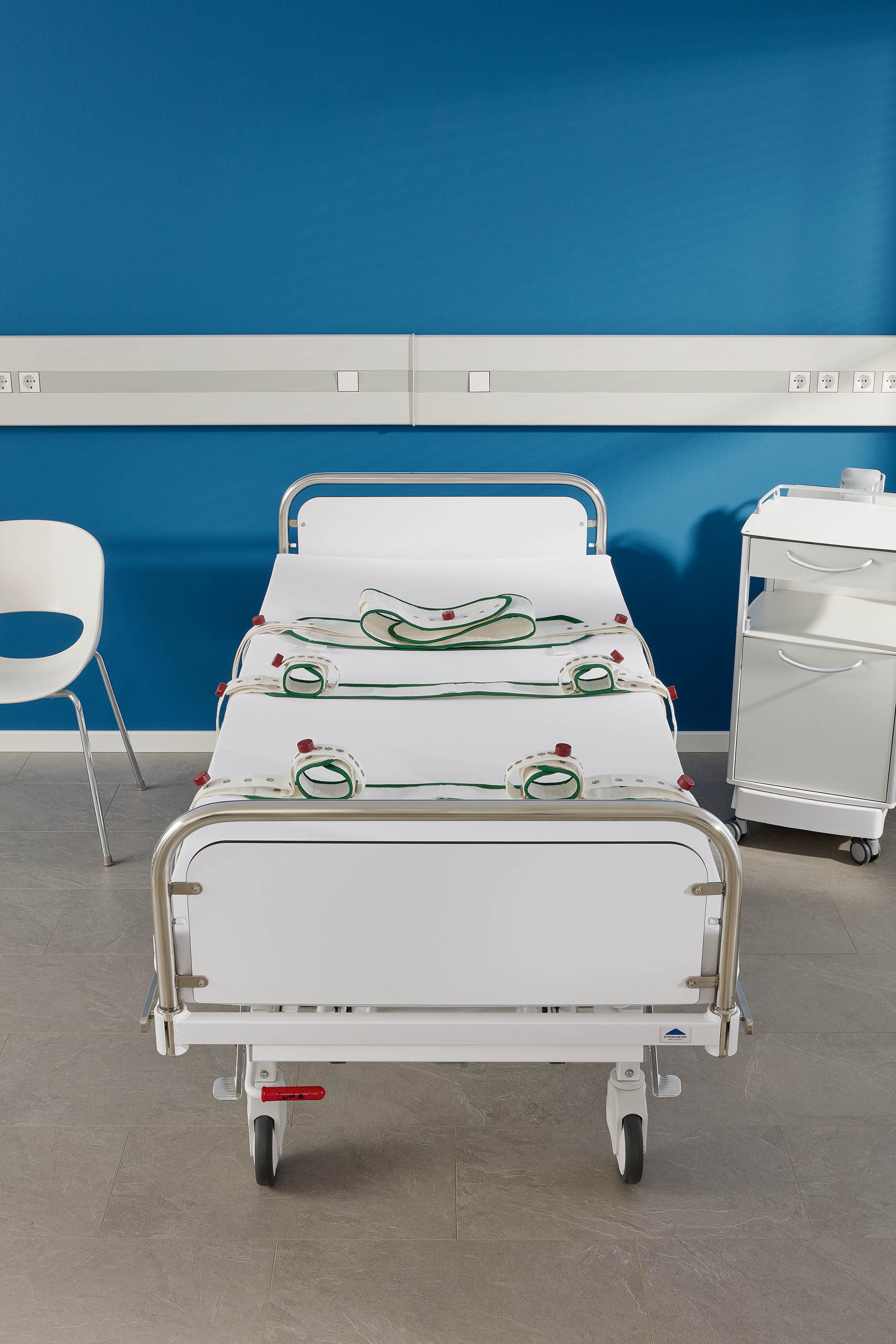 Fixation points for belts on the Deka hospital bed